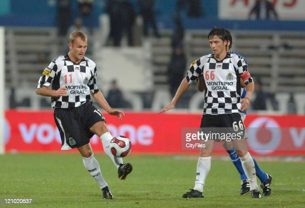 Grzelak and Tiago in action at a Portuguese Soccer League match between Belenenses and Boavista in Lisbon Potugal on October 1 2006