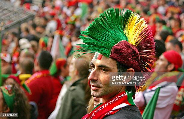 Portuguese supporters attend Portugal's football team training session at the Heidewald stadium in Gutersloh 05 June 2006 ahead of the FIFA World Cup...