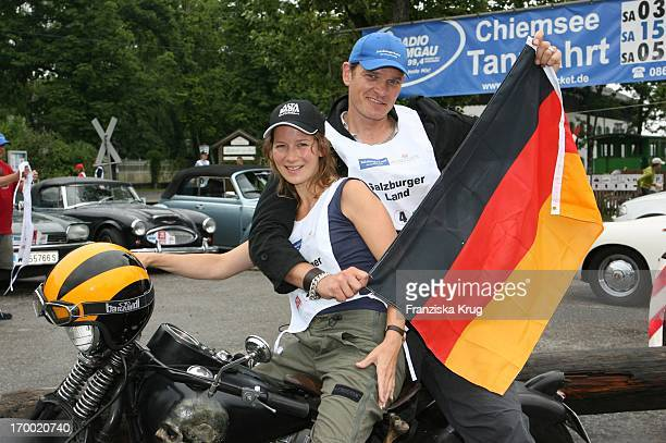 Götz Otto and his wife Sabine at Germany flag when big border traffic in Prien Am Chiemsee 230606