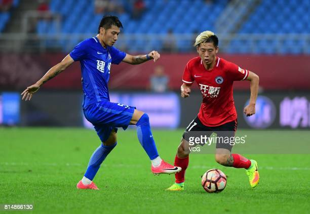 Gu Cao of Henan Jianye and Liu Shangkun of Liaoning Whowin compete for the ball during the 17th round match of 2017 Chinese Football Association...