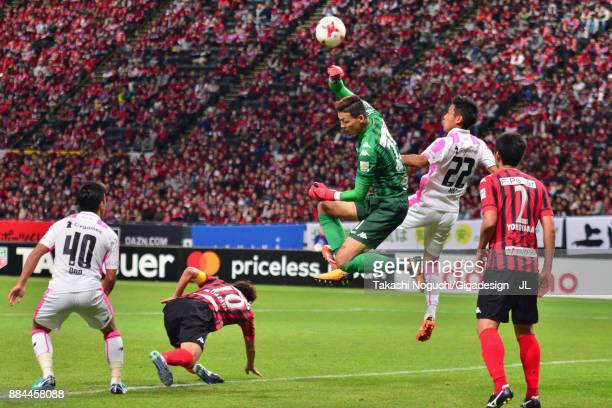 Gu Sung Yun of Consadole Sapporo and Kei Ikeda of Sagan Tosu compete for the ball during the JLeague J1 match between Consadole Sapporo and Sagan...