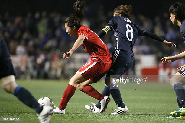 Gu Yasha of China and Miyama Aya of Japan compete for the ball during the AFC Women's Olympic Final Qualification Round match between Japan and China...