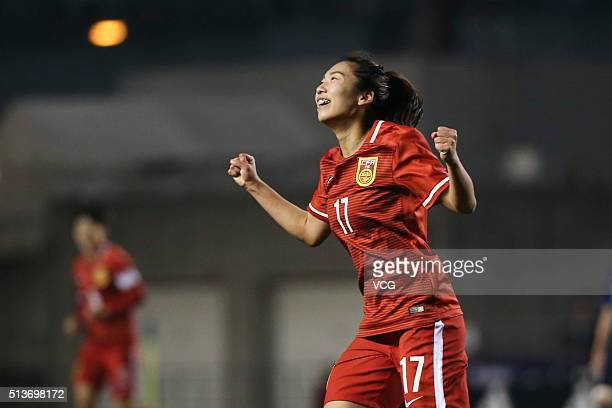 Gu Yasha of China celebrates after scoring her team's second goal during the AFC Women's Olympic Final Qualification Round match between Japan and...