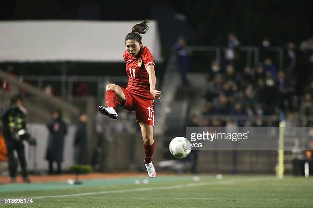 Gu Yasha of China drives the ball during the AFC Women's Olympic Final Qualification Round match between Japan and China at Kincho Stadium on March...
