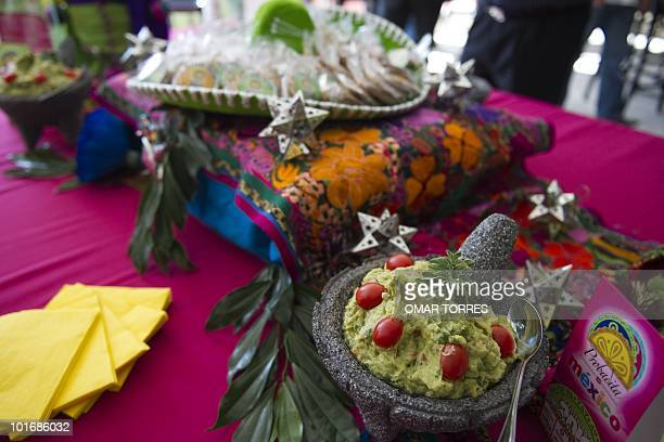 Guacamole and other Mexican appetizers are displayed during the Litlle Taste of Mexico presentation a gastronomic promotion at the Ellis Park stadium...
