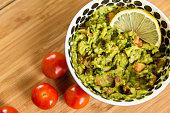 bowl guacamole with limon tomato wood