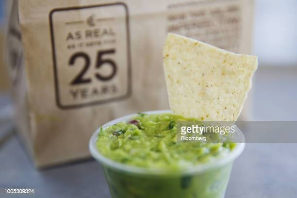 Guacamole and tortilla chips are arranged for a photograph at a Chipotle Mexican Grill Inc restaurant in El Segundo California US on Wednesday July...