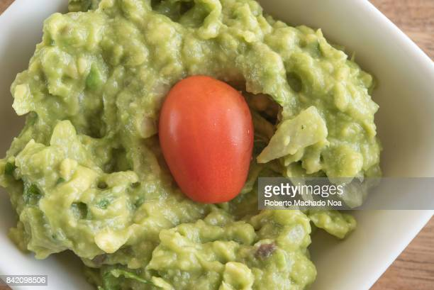 Guacamole close up of the traditional Central American spread food 'Guac' is an avocadobased dip or salad first developed by the Aztecs in what is...