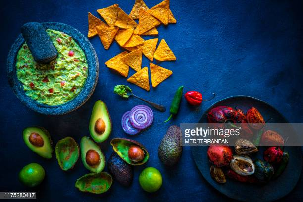guacamole of avocado with chili roasted - guacamole stock pictures, royalty-free photos & images