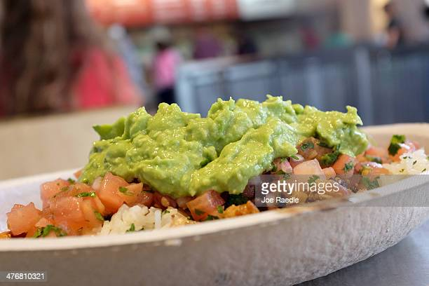 Guacamole sits on a dish at a Chipotle restaurant on March 5 2014 in Miami Florida The Mexican fast food chain is reported to have tossed around the...