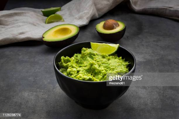 guacamole with lime - guacamole stock photos and pictures
