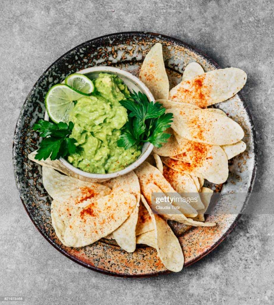 Guacamole with tortilla chips : Stock Photo