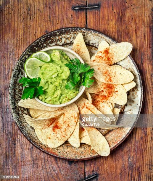 guacamole with tortilla chips - guacamole stock photos and pictures