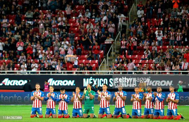 Guadalajara and Veracruz players keep a minute of silence for the death of businessman and owner of Guadalajara Soccer Club Jorge Vergara prior to...