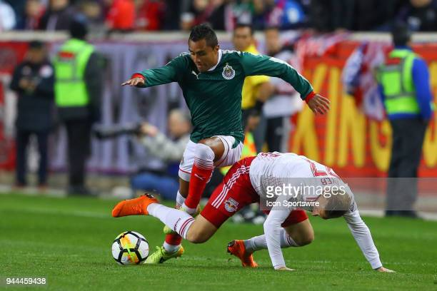 Guadalajara defender Edwin Hernandez battles New York Red Bulls midfielder Daniel Royer during the first half of the CONCACAF Champions League game...