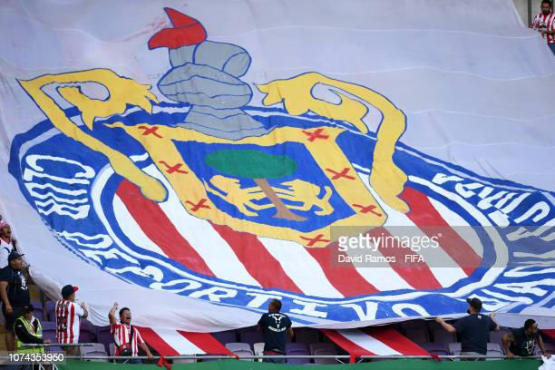 Guadalajara fans wave a flag in the stands prior to the FIFA Club World Cup UAE 2018 5th Place Match between ES Tunis and CD Guadalajara at Hazza Bin...