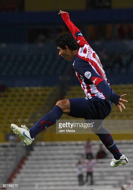 Guadalajara' Jonny Magallon celebrates a goal during their match in the 2009 Opening tournament the closing stage of the Mexican Football League at...
