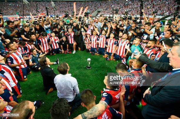 Guadalajara players and owner Jorge Vergara celebrate their victory against Tigres during the final match of the Mexican Clausura 2017 football...