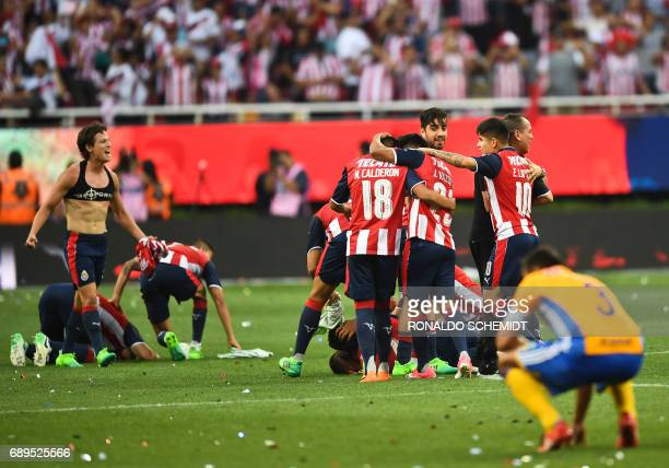 Guadalajara players celebrate their victory against Tigres during the final match of the Mexican Clausura 2017 football tournament, at the Chivas...