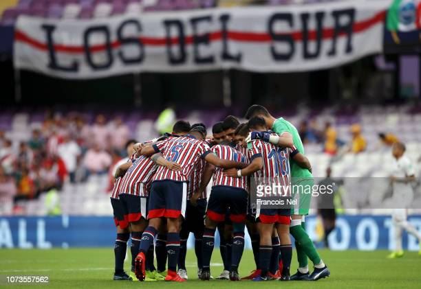 Guadalajara players form a huddle prior to the FIFA Club World Cup UAE 2018 Second round match between Kashima Antlers and CD Guadalajara at the...