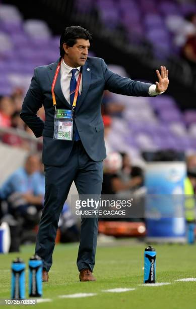 Guadalajara's coach Jose Cardozo speaks to his players during the second round match of the FIFA Club World Cup 2018 football tournament between...