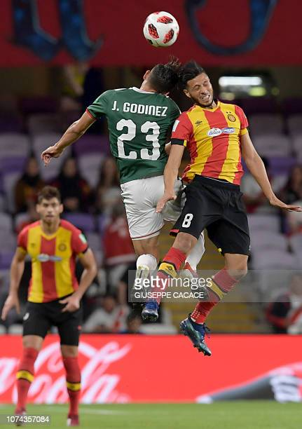 Guadalajara's forward Jose Godinez fights for the ball with ES Tunis' forward Anice Badri during the fifth place match of the FIFA Club World Cup...