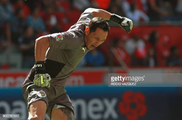 Guadalajara's goalie Rodolfo Cota celebrates their goal against Toluca during their Mexican Clausura football tournament match at the Nemesio Diez...