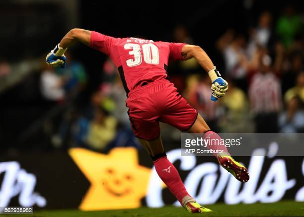 Guadalajara's goalkereper Rodolfo Cota celebrates the goal of his teammate Carlos Cisneros against America during their Mexican Apertura tournament...