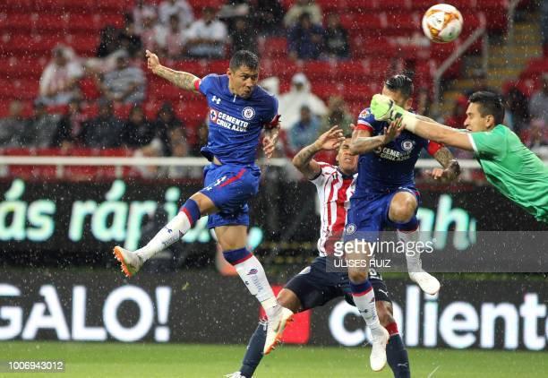 Guadalajara's Mexican goalkeeper Raul Gudino vies for the ball with Cruz Azul's Mexican midfielder Julio Dominguez and Mexican midfielder Edgar...