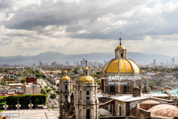 guadalupe basilica church and mexico city skyline - mexico city stock pictures, royalty-free photos & images