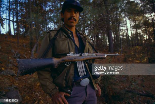 Guadalupe Rivas Vega, on the run from both the police and narcos after he killed a local gunman, hides in the mountains, May of 1998, in the Sierra...
