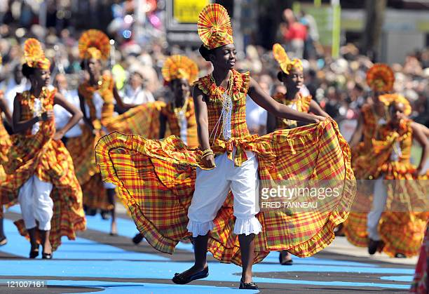 Guadeloupean dancers perform on August 7 2011 in Lorient during the celtics nations Great Parade of the 'festival interceltique de Lorient' It is the...