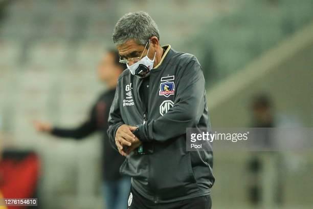 Gualberto Jara coach of ColoColo checks his watch during a group C match of Copa CONMEBOL Libertadores 2020 between Athletico Paranaense and ColoColo...