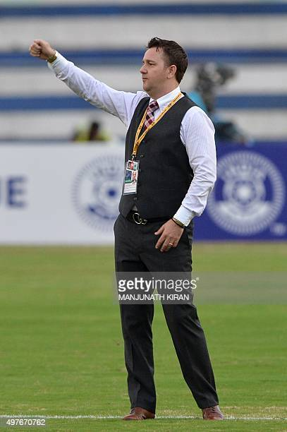 Guam football team coach Gary White gestures prior to the start of the Asia Group D FIFA World Cup 2018 qualifying football match between India and...