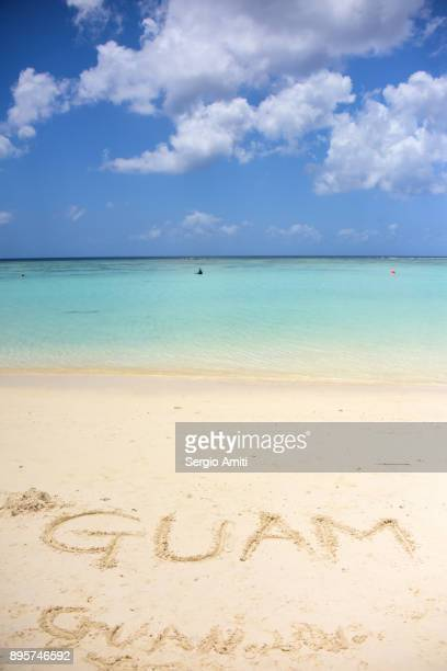 """""""guam"""" written in the sand - guam stock pictures, royalty-free photos & images"""