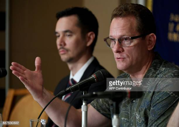 Guam's Lieutenant Governor Raymond Tenorio speaks beside Guam Visitors Bureau president and CEO Jon Nathan Denight during a press conference at the...