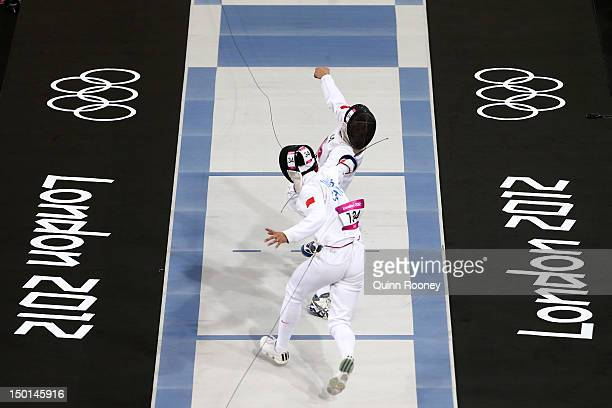 Guan Wang of China competes against Ondrej Polivka of Czech Republic in the Fencing event in the Men's Modern Pentathlon on Day 15 of the London 2012...
