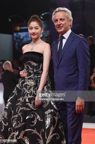 Guan Xiaotong and Jerome Favier walk the red carpet ahead of the Ying and 2018 JaegerLeCoultre Glory to the Filmaker Award to Zhang Yimou during the...