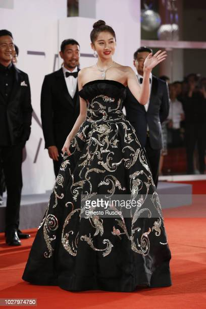 Guan Xiaotong attends 'Ying ' screening and 2018 JaegerLeCoultre Glory To The Filmaker Award to Zhang Yimou during the 75th Venice Film Festival at...