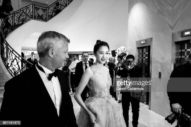 Guan Xiaotong departs the Martinez Hotel ahead of the 'Ash Is The Purest White ' during the 71st annual Cannes Film Festival at on May 11 2018 in...