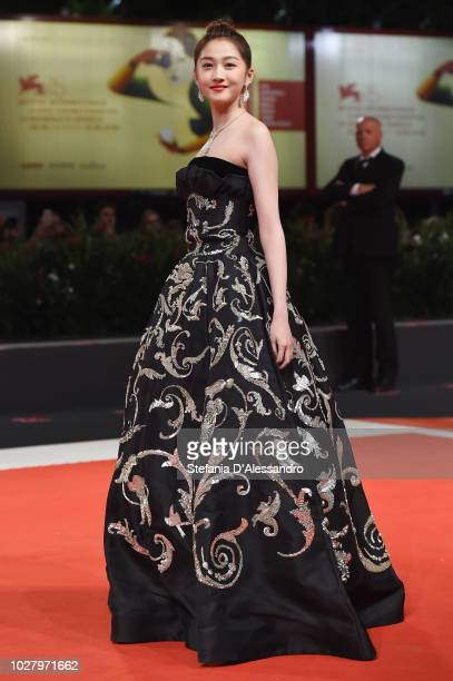 Guan Xiaotong walks the red carpet ahead of the Ying and 2018 JaegerLeCoultre Glory to the Filmaker Award to Zhang Yimou during the 75th Venice Film...