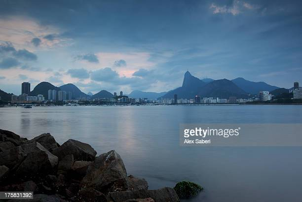 guanabara bay and rio de janeiro with christ the redeemer statue. - alex saberi stock pictures, royalty-free photos & images