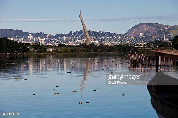 Guanabara Bay pollution garbage bags floating at Canal do Fundao near Favela da Mare