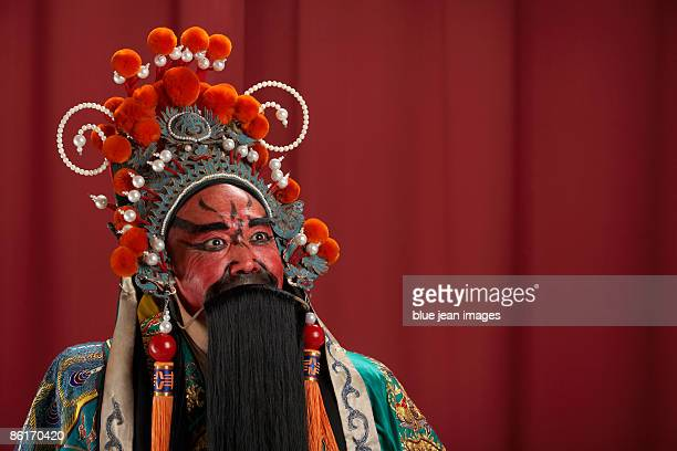 guang gong, ancient chinese general in beijing opera costume, represents protection and wealth - beijing opera stock photos and pictures