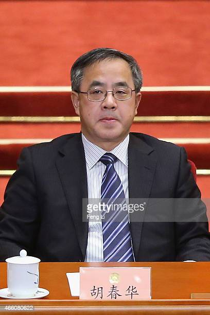 Guangdong Communist Party Secretary Hu Chunhua attends the closing session of the Chinese People's Political Consultative Conference at the Great...