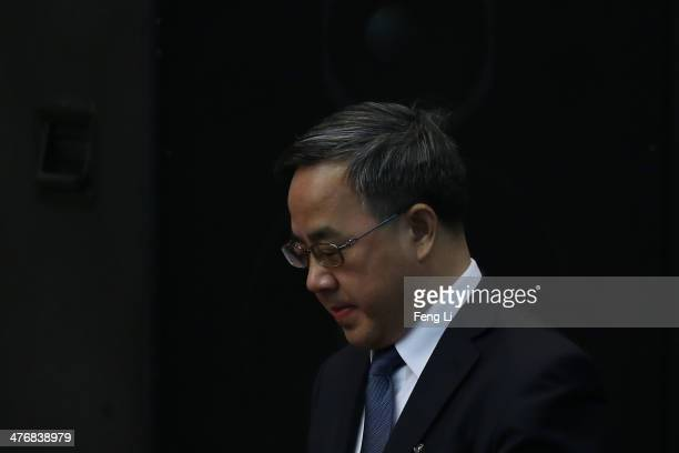 Guangdong Communist Party Secretary Hu Chunhua attends the Guangdong delegation's group meeting during the annual National People's Congress on March...