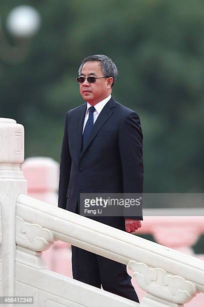 Guangdong Communist Party Secretary Hu Chunhua walks past the Monument to the People's Heroes during a ceremony marking Martyr¯s Day at Tiananmen...