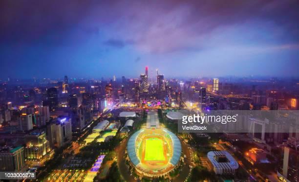 guangdong province, guangzhou tianhe sports center building at night - tianhe stadion stock-fotos und bilder