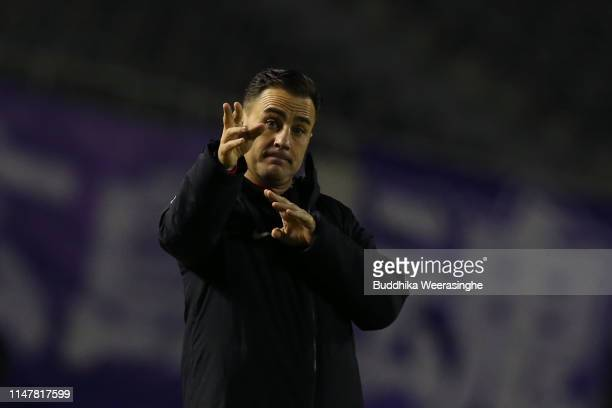 Guangzhou Evergrande coach Fabio Cannavaro reacts during the AFC Champions League Group F match between Sanfrecce Hiroshima and Guangzhou Evergrande...