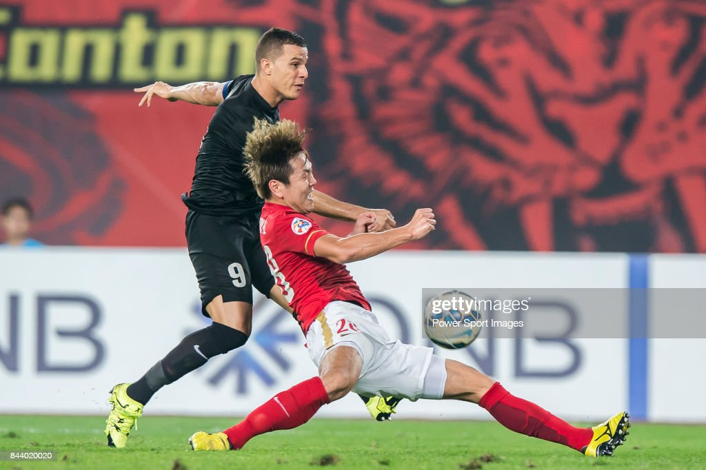 Guangzhou Evergrande defender Kim Young Gwon (R) fights for the ball with Al Ahli forward Rodrigo Jose Lima Dos Santos (L) during the AFC Champions League Final Match 2nd Leg match between Guangzhou Evergrande vs Al Ahli on 21 November 2015 at the Tianhe Sport Center in Guangzhou, China.